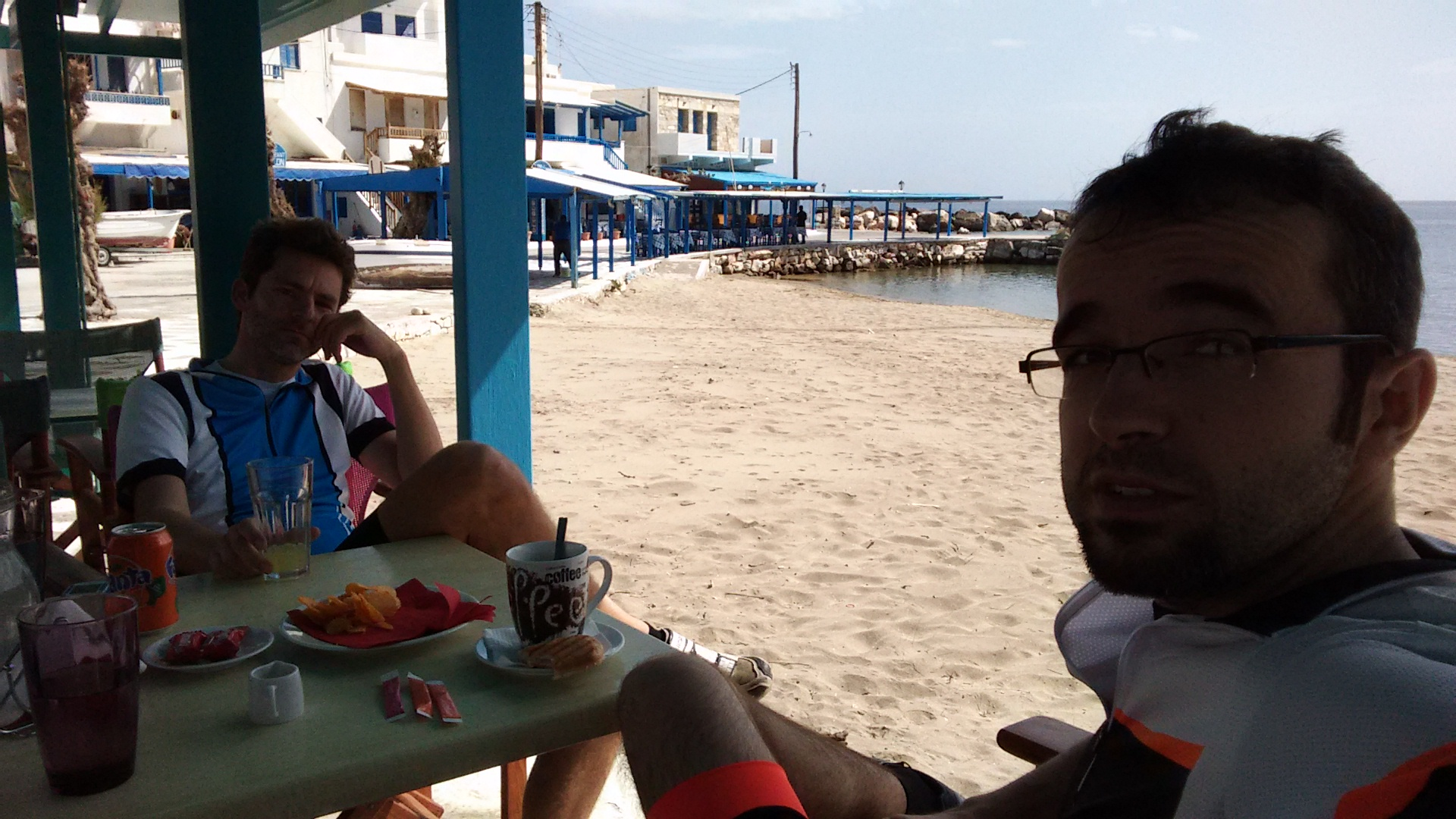 Coffee break at Apollonas, sitting by the beach