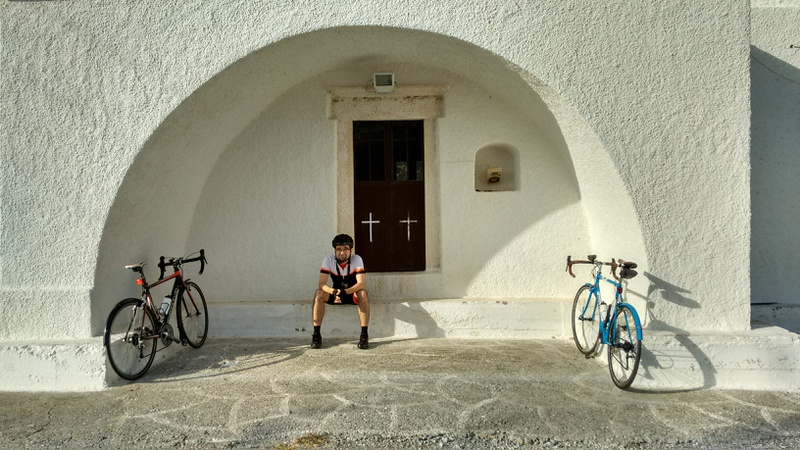 Me, sitting in the shadow of the church in Stavros