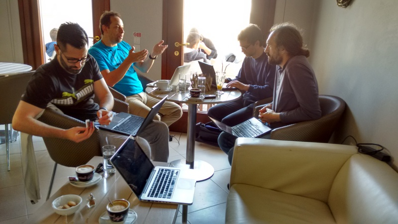 Oscar, Panos, Sascha and Grigori, working from a café in Halki