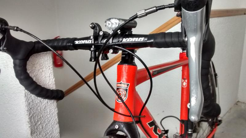 A closer view of handlebar (with addons) and the break levers